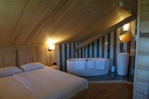 Un ou plusieurs lits dans un hébergement de l'établissement Maison d'hôtes La Barmaz