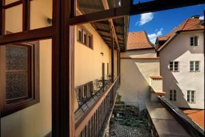 A balcony or terrace at Pension Rozmarýna