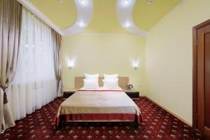 Кровать или кровати в номере Вилла Маск