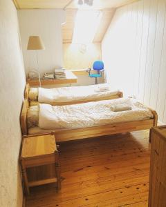 A bed or beds in a room at Jolando Apartment