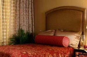 A bed or beds in a room at Jockey Club Suites