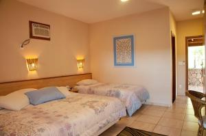 A bed or beds in a room at Spa Recanto