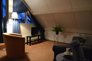A seating area at Bed & Breakfast Giethoorn
