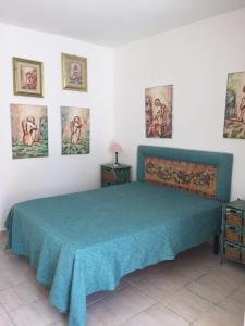 Letto o letti in una camera di Casa Del Marchese