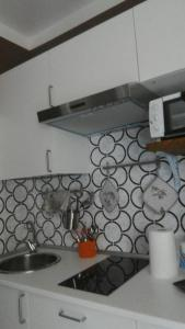 A kitchen or kitchenette at Camere In Centro