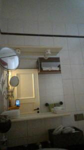 A bathroom at Camere In Centro