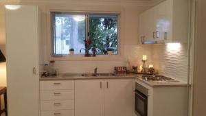 A kitchen or kitchenette at Epping NSW