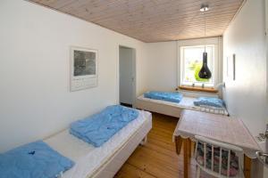 A bed or beds in a room at Annekset Vesterø Havn