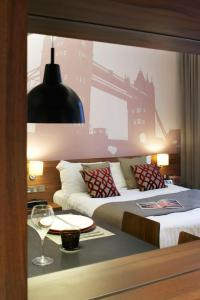 A bed or beds in a room at Citadines Holborn - Covent Garden London