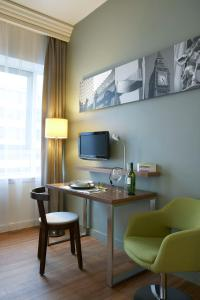 A television and/or entertainment center at Citadines Holborn - Covent Garden London