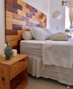 A bed or beds in a room at Villa Mar Residence