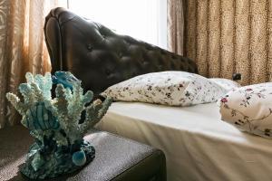 Кровать или кровати в номере Apartment Nice Ulitsa 1905 Goda