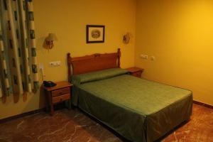 Cama o camas de una habitación en Hotel Albohera