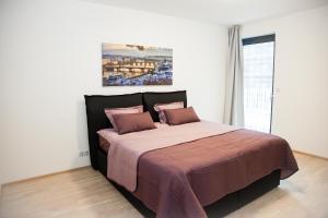Postel nebo postele na pokoji v ubytování Garden Towers Apartments