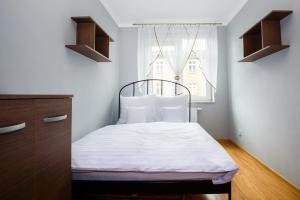 Ein Bett oder Betten in einem Zimmer der Unterkunft Supreme Apartments Ściegiennego