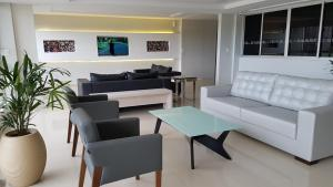 A seating area at Max Hotel