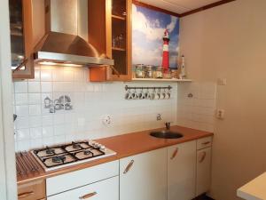Küche/Küchenzeile in der Unterkunft OESTER Bed by the Sea