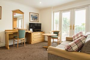 A seating area at Annexe at Gosfield Lake