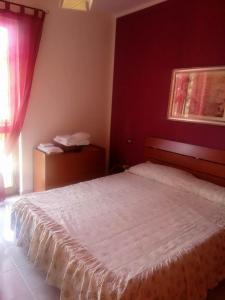 Letto o letti in una camera di Adriana Apartment