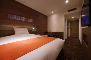 A bed or beds in a room at Hotel JAL City Sendai