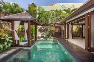 The swimming pool at or close to Villa Green Mango