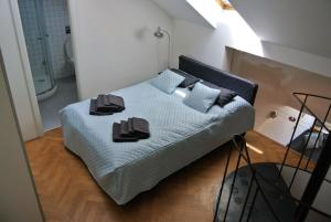 A bed or beds in a room at Prague Letna Apartments