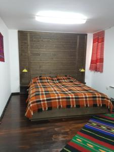 A bed or beds in a room at Holiday Village Kochorite