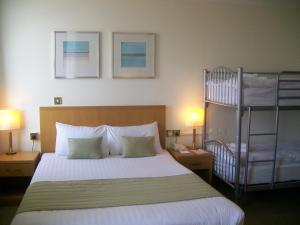 A bed or beds in a room at Carousel Hotel