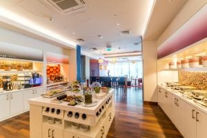 A restaurant or other place to eat at Hampton by Hilton Warsaw Airport