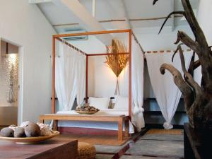 Кровать или кровати в номере Bliss Boutique Hotel Seychelles