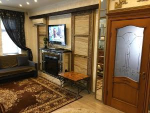 Телевизор и/или развлекательный центр в Апартаменты на Советов 62