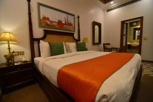 A bed or beds in a room at Haveli Dharampura - UNESCO awarded Boutique Heritage Hotel