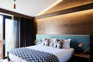 A bed or beds in a room at Astra Falls Creek