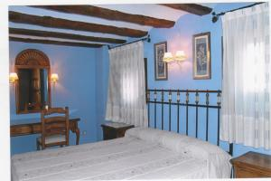 A bed or beds in a room at Parada del Carmen
