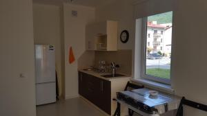 Кухня или мини-кухня в Апартаменты в Резиденции Утриш