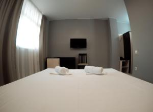 Кровать или кровати в номере Отель Айсберг