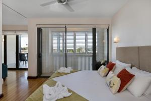 A bed or beds in a room at Boathouse Port of Airlie