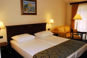 A bed or beds in a room at Hotel Meridijan Adults Only