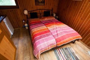 Postel nebo postele na pokoji v ubytování Bungalov u Draka Vřesina