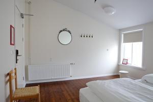 Ein Bett oder Betten in einem Zimmer der Unterkunft Akureyri Backpackers
