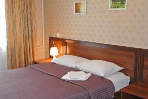 Кровать или кровати в номере Отель Родник Чагода