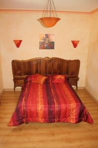 Un ou plusieurs lits dans un hébergement de l'établissement La Demeure de Bayard
