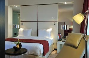 A bed or beds in a room at Pullman Kinshasa Grand Hotel