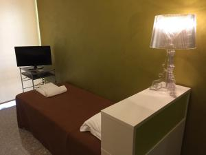 A bed or beds in a room at Vip Bergamo Apartments