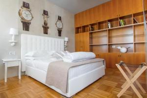 Letto o letti in una camera di Ginevra Rooms