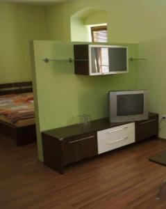 A television and/or entertainment center at Penzion Stara Fara