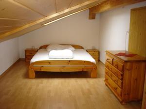 Ein Bett oder Betten in einem Zimmer der Unterkunft Chalet Sunneschyn