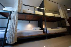 A bunk bed or bunk beds in a room at Varinda Hostel