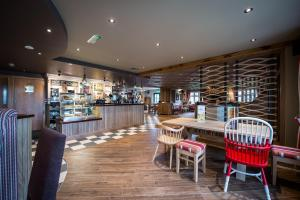 A restaurant or other place to eat at Sweet Chestnut, Dunfermline by Marston's Inns