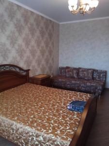 Кровать или кровати в номере 1-к на Московском